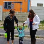 Kattie Whitelaw '14 (L) and Lauren Barbera '15 (R) making a new friend in Langa Township.